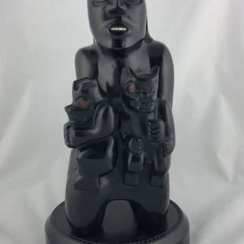 Bear Mother carved in Argillite featuring Abalone and Red Argillite inlays carved by Haida Artist Greg White