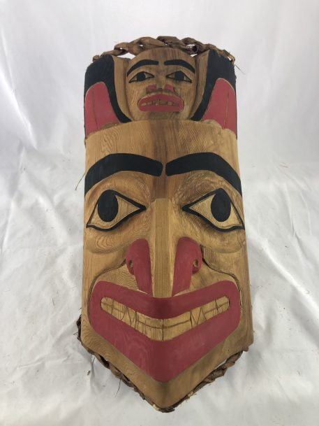 The Bear People Mask carved in cedar by Haida Artist John Watts.
