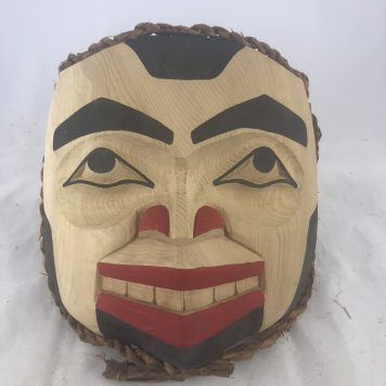 Human Mask carved in Cedar by Haida Artist John Watts.
